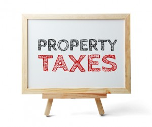 Whiteboard with text Property Taxes is isolated on the white background.